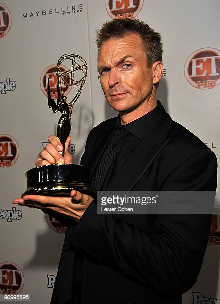 Host Phil Keoghan pposes with his Emmy for Outstanding RealityCompetition Program for 'The Amazing Race' at the 13th Annual Entertainment Tonight and...