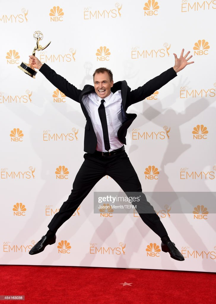 Host Phil Keoghan winner of the Outstanding Reality Competition Program Award for The Amazing Race poses in the press room during the 66th Annual...