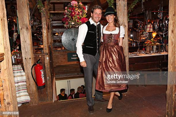 Host Philip Greffenius and his wife Evelyn attend the 'Almauftrieb' at Kaefer tent during Oktoberfest at Theresienwiese on September 21 2014 in...