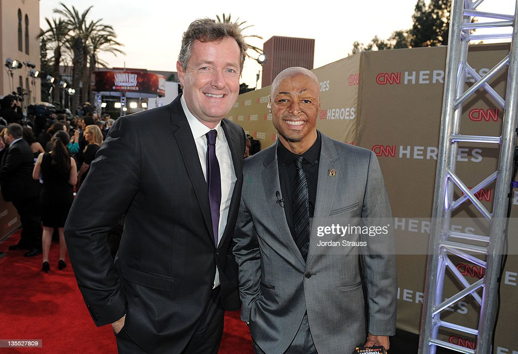CNN Host Piers Morgan and J.R. Martinez arrive at 2011 CNN Heroes: An All-Star Tribute at The Shrine Auditorium on December 11, 2011 in Los Angeles, California. 21959_008_JS2_0322.JPG