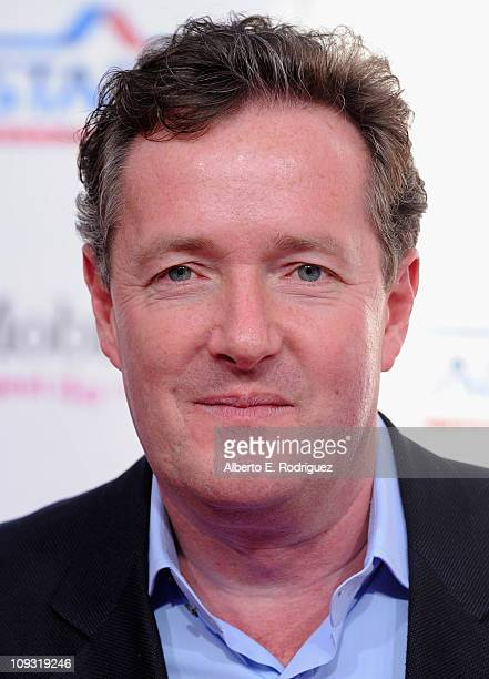 TV host Piers Morgan arrives to the TMobile Magenta Carpet at the 2011 NBA AllStar Game on February 20 2011 in Los Angeles California