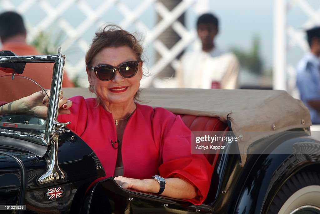 A TV host poses with a car during the Pre Judging of the Cartier 'Travel With Style' Concours 2013 Opening at Taj Lands End on February 9, 2013 in Mumbai, India.