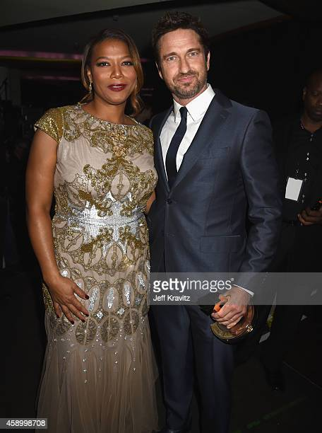 Host Queen Latifah and honoree Gerard Butler pose backstage at the 18th Annual Hollywood Film Awards at The Palladium on November 14 2014 in...