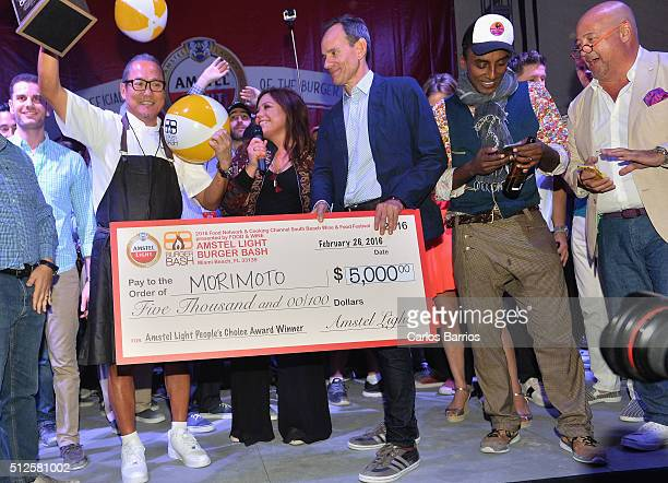 Host Rachael Ray presents the Amstel® Light People's Choice Award at the Amstel® Light Burger Bash to Iron Chef Masaharu Morimoto during the 2016...