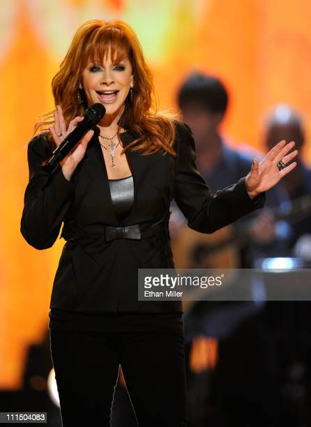 Host Reba McEntire performs onstage at the 46th Annual Academy Of Country Music Awards held at the MGM Grand Garden Arena on April 3 2011 in Las...