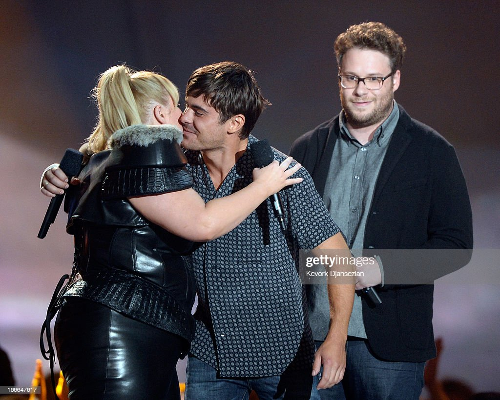 Host Rebel Wilson, actors Zac Efron and Seth Rogen speak onstage during the 2013 MTV Movie Awards at Sony Pictures Studios on April 14, 2013 in Culver City, California.