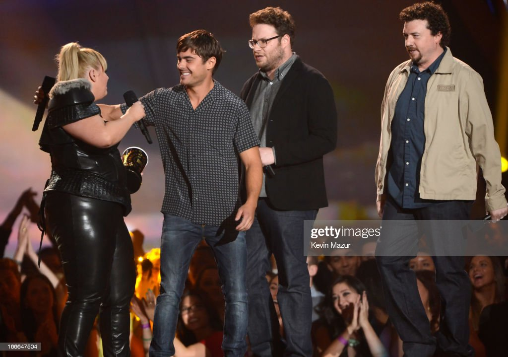 Host Rebel Wilson and actors Seth Rogen, Zac Efron and Danny McBride speak onstage during the 2013 MTV Movie Awards at Sony Pictures Studios on April 14, 2013 in Culver City, California.