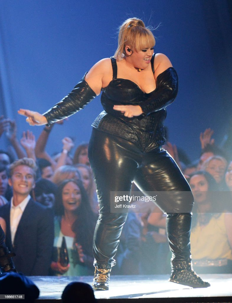 Host <a gi-track='captionPersonalityLinkClicked' href=/galleries/search?phrase=Rebel+Wilson&family=editorial&specificpeople=5563104 ng-click='$event.stopPropagation()'>Rebel Wilson</a> performs onstage during the 2013 MTV Movie Awards at Sony Pictures Studios on April 14, 2013 in Culver City, California.