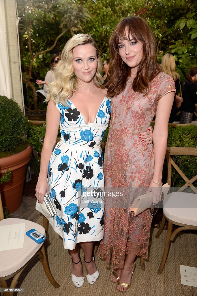 Host Reese Witherspoon (L) and actress Dakota Johnson attend the 2014 CFDA/Vogue Fashion Fund Event presented by thecorner.com and supported by Aveda, Lexus, and Maybelline New York at Chateau Marmont on October 21, 2014 in Los Angeles, California.