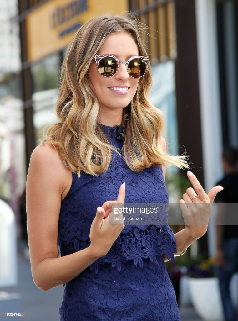 EXTRA host <a gi-track='captionPersonalityLinkClicked' href=/galleries/search?phrase=Renee+Bargh&family=editorial&specificpeople=4267341 ng-click='$event.stopPropagation()'>Renee Bargh</a> shows off the latest Spring/Summer Sunglass trends at Westfield Century City on May 13, 2014 in Los Angeles, California.
