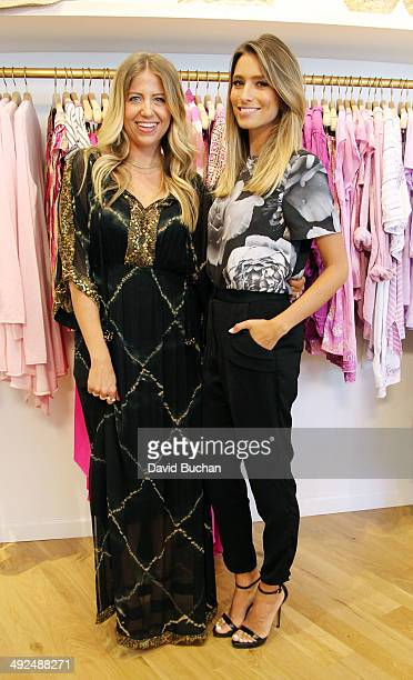 EXTRA host Renee Bargh with Style expert Lindsay Albanese films at Calypso St Barth at Westfield Century City on May 20 2014 in Los Angeles California