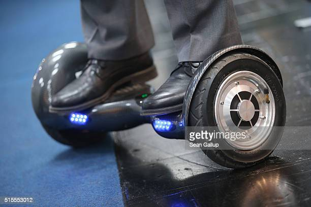 A host rides a BykeBoard hoverboard at the 2016 CeBIT digital technology trade fair on the fair's opening day on March 14 2016 in Hanover Germany The...
