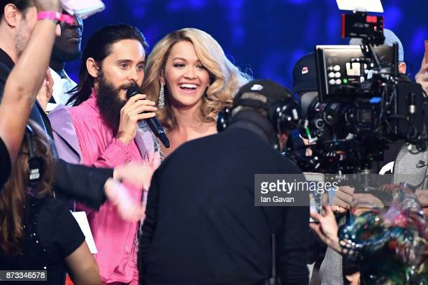 Host Rita Ora speaks to Jared Leto of Thirty Seconds to Mars after the band won the award for Best Alternative on stage during the MTV EMAs 2017 held...