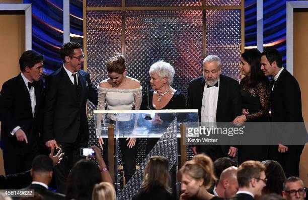 Host Rob Brydon Honorees Robert Downey Jr Emma Watson Dame Judi Dench Mike Leigh OBE Julia LouisDreyfus and Mark Ruffalo pose onstage at the BAFTA...