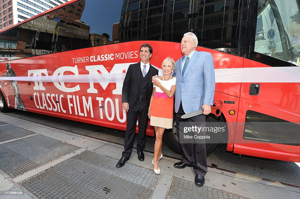 TCM host Robert Osborne (R) is joined by actress Jane Powell (C) and Dennis Adamovich (L), Senior Vice President of digital, affiliate, lifestyle and enterprise commerce, TCM, TBS and TNT to launch the 'TCM Classic Film Tour' on August 20, 2013 in New York City. Featuring stops at some of the most famous movie locations throughout the city, this sightseeing bus tour opens to the public Thursday, Aug. 22, running Tuesdays, Thursdays and Saturdays, beginning at 11:30 a.m. The three-hour sightseeing bus tour will take movie fans to some of the city's greatest filming locations, including the Empire State Building (King Kong); Zabar's market (Manhattan, You've Got Mail); Holly Golightly's brownstone (Breakfast at Tiffany's); the famed subway grate that blew Marilyn Monroe's skirt (The Seven-Year Itch); Grand Central Terminal (North by Northwest, Superman); and, of course, Central Park. (Photo by Mike Coppola/WireImage) 23987_004_MC_ 0022.JPG Robert Osborne; Jane Powell; Dennis Adamovich
