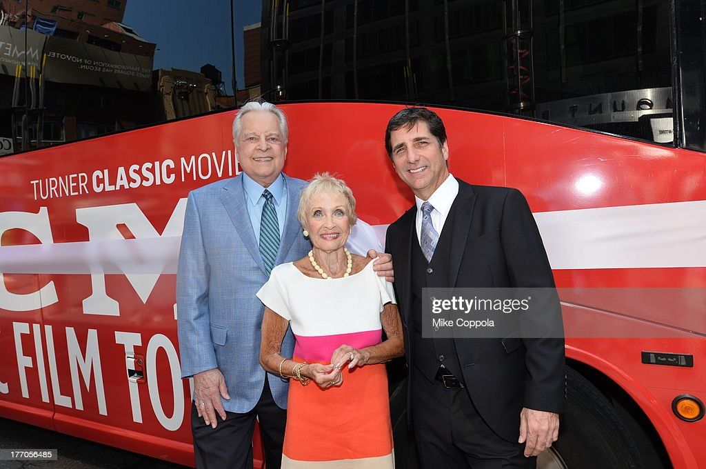 TCM host Robert Osborne (L) is joined by actress Jane Powell (C) and Dennis Adamovich (R), Senior Vice President of digital, affiliate, lifestyle and enterprise commerce, TCM, TBS and TNT to launch the 'TCM Classic Film Tour' on August 20, 2013 in New York City. Featuring stops at some of the most famous movie locations throughout the city, this sightseeing bus tour opens to the public Thursday, Aug. 22, running Tuesdays, Thursdays and Saturdays, beginning at 11:30 a.m. The three-hour sightseeing bus tour will take movie fans to some of the city's greatest filming locations, including the Empire State Building (King Kong); Zabar's market (Manhattan, You've Got Mail); Holly Golightly's brownstone (Breakfast at Tiffany's); the famed subway grate that blew Marilyn Monroe's skirt (The Seven-Year Itch); Grand Central Terminal (North by Northwest, Superman); and, of course, Central Park. (Photo by Mike Coppola/WireImage) 23987_004_MC_ 0029.JPG Robert Osborne; Jane Powell; Dennis Adamovich