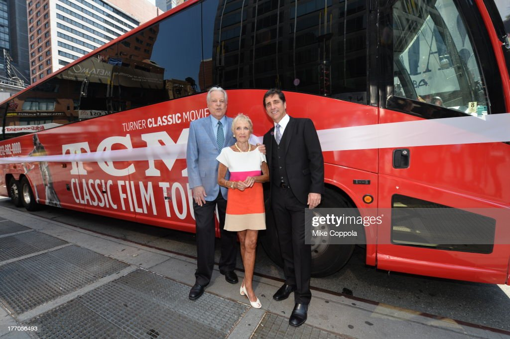TCM host Robert Osborne (L) is joined by actress Jane Powell (C) and Dennis Adamovich (R), Senior Vice President of digital, affiliate, lifestyle and enterprise commerce, TCM, TBS and TNT to launch the 'TCM Classic Film Tour' on August 20, 2013 in New York City. Featuring stops at some of the most famous movie locations throughout the city, this sightseeing bus tour opens to the public Thursday, Aug. 22, running Tuesdays, Thursdays and Saturdays, beginning at 11:30 a.m. The three-hour sightseeing bus tour will take movie fans to some of the city's greatest filming locations, including the Empire State Building (King Kong); Zabar's market (Manhattan, You've Got Mail); Holly Golightly's brownstone (Breakfast at Tiffany's); the famed subway grate that blew Marilyn Monroe's skirt (The Seven-Year Itch); Grand Central Terminal (North by Northwest, Superman); and, of course, Central Park. (Photo by Mike Coppola/WireImage) 23987_004_MC_ 0030.JPG Robert Osborne; Jane Powell; Dennis Adamovich