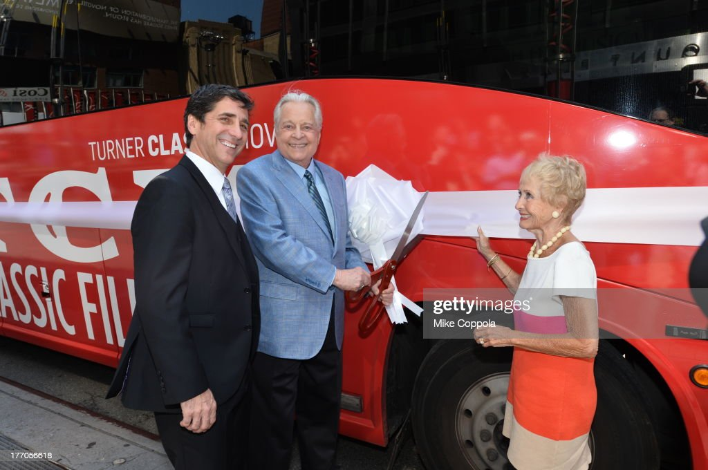 TCM host Robert Osborne (C) is joined by actress Jane Powell (R) and Dennis Adamovich (L), Senior Vice President of digital, affiliate, lifestyle and enterprise commerce, TCM, TBS and TNT to launch the 'TCM Classic Film Tour' on August 20, 2013 in New York City. Featuring stops at some of the most famous movie locations throughout the city, this sightseeing bus tour opens to the public Thursday, Aug. 22, running Tuesdays, Thursdays and Saturdays, beginning at 11:30 a.m. The three-hour sightseeing bus tour will take movie fans to some of the city's greatest filming locations, including the Empire State Building (King Kong); Zabar's market (Manhattan, You've Got Mail); Holly Golightly's brownstone (Breakfast at Tiffany's); the famed subway grate that blew Marilyn Monroe's skirt (The Seven-Year Itch); Grand Central Terminal (North by Northwest, Superman); and, of course, Central Park. (Photo by Mike Coppola/WireImage) 23987_004_MC_ 0042.JPG Robert Osborne; Jane Powell; Dennis Adamovich