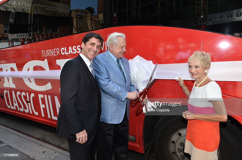 TCM host Robert Osborne (C) is joined by actress Jane Powell (R) and Dennis Adamovich (L), Senior Vice President of digital, affiliate, lifestyle and enterprise commerce, TCM, TBS and TNT to launch the 'TCM Classic Film Tour' on August 20, 2013 in New York City. Featuring stops at some of the most famous movie locations throughout the city, this sightseeing bus tour opens to the public Thursday, Aug. 22, running Tuesdays, Thursdays and Saturdays, beginning at 11:30 a.m. The three-hour sightseeing bus tour will take movie fans to some of the city's greatest filming locations, including the Empire State Building (King Kong); Zabar's market (Manhattan, You've Got Mail); Holly Golightly's brownstone (Breakfast at Tiffany's); the famed subway grate that blew Marilyn Monroe's skirt (The Seven-Year Itch); Grand Central Terminal (North by Northwest, Superman); and, of course, Central Park. (Photo by Mike Coppola/WireImage) 23987_004_MC_ 0043.JPG Robert Osborne; Jane Powell; Dennis Adamovich