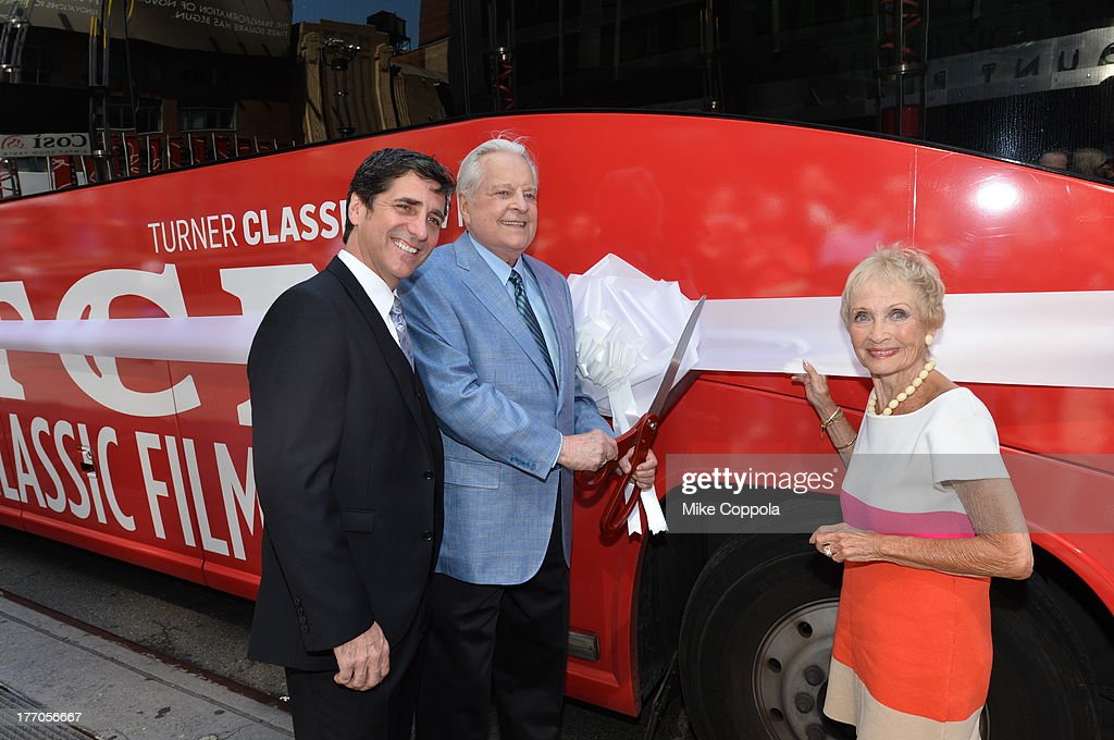 TCM host Robert Osborne (C) is joined by actress Jane Powell (R) and Dennis Adamovich (L), Senior Vice President of digital, affiliate, lifestyle and enterprise commerce, TCM, TBS and TNT to launch the 'TCM Classic Film Tour' on August 20, 2013 in New York City. Featuring stops at some of the most famous movie locations throughout the city, this sightseeing bus tour opens to the public Thursday, Aug. 22, running Tuesdays, Thursdays and Saturdays, beginning at 11:30 a.m. The three-hour sightseeing bus tour will take movie fans to some of the city's greatest filming locations, including the Empire State Building (King Kong); Zabar's market (Manhattan, You've Got Mail); Holly Golightly's brownstone (Breakfast at Tiffany's); the famed subway grate that blew Marilyn Monroe's skirt (The Seven-Year Itch); Grand Central Terminal (North by Northwest, Superman); and, of course, Central Park. (Photo by Mike Coppola/WireImage) 23987_004_MC_ 0045.JPG Robert Osborne; Jane Powell; Dennis Adamovich
