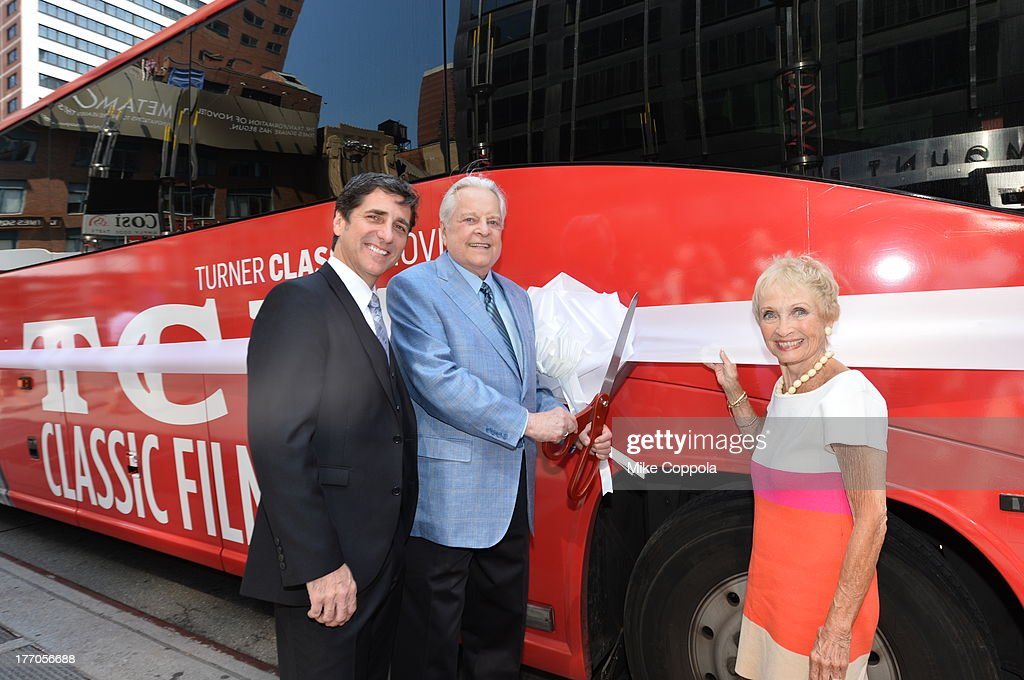 TCM host Robert Osborne (C) is joined by actress Jane Powell (R) and Dennis Adamovich (L), Senior Vice President of digital, affiliate, lifestyle and enterprise commerce, TCM, TBS and TNT to launch the 'TCM Classic Film Tour' on August 20, 2013 in New York City. Featuring stops at some of the most famous movie locations throughout the city, this sightseeing bus tour opens to the public Thursday, Aug. 22, running Tuesdays, Thursdays and Saturdays, beginning at 11:30 a.m. The three-hour sightseeing bus tour will take movie fans to some of the city's greatest filming locations, including the Empire State Building (King Kong); Zabar's market (Manhattan, You've Got Mail); Holly Golightly's brownstone (Breakfast at Tiffany's); the famed subway grate that blew Marilyn Monroe's skirt (The Seven-Year Itch); Grand Central Terminal (North by Northwest, Superman); and, of course, Central Park. (Photo by Mike Coppola/WireImage) 23987_004_MC_ 0052.JPG Robert Osborne; Jane Powell; Dennis Adamovich