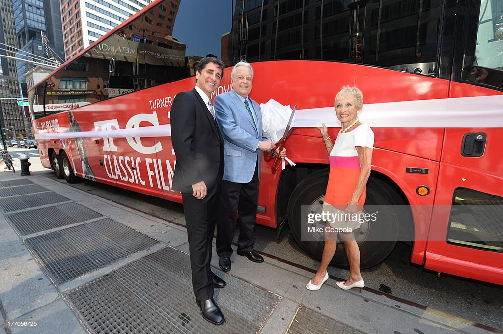 TCM host Robert Osborne (C) is joined by actress Jane Powell (R) and Dennis Adamovich (L), Senior Vice President of digital, affiliate, lifestyle and enterprise commerce, TCM, TBS and TNT to launch the 'TCM Classic Film Tour' on August 20, 2013 in New York City. Featuring stops at some of the most famous movie locations throughout the city, this sightseeing bus tour opens to the public Thursday, Aug. 22, running Tuesdays, Thursdays and Saturdays, beginning at 11:30 a.m. The three-hour sightseeing bus tour will take movie fans to some of the city's greatest filming locations, including the Empire State Building (King Kong); Zabar's market (Manhattan, You've Got Mail); Holly Golightly's brownstone (Breakfast at Tiffany's); the famed subway grate that blew Marilyn Monroe's skirt (The Seven-Year Itch); Grand Central Terminal (North by Northwest, Superman); and, of course, Central Park. (Photo by Mike Coppola/WireImage) 23987_004_MC_ 0054.JPG Robert Osborne; Jane Powell; Dennis Adamovich
