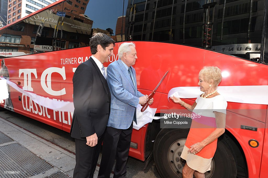 TCM host Robert Osborne (C) is joined by actress Jane Powell (R) and Dennis Adamovich (L), Senior Vice President of digital, affiliate, lifestyle and enterprise commerce, TCM, TBS and TNT to launch the 'TCM Classic Film Tour' on August 20, 2013 in New York City. Featuring stops at some of the most famous movie locations throughout the city, this sightseeing bus tour opens to the public Thursday, Aug. 22, running Tuesdays, Thursdays and Saturdays, beginning at 11:30 a.m. The three-hour sightseeing bus tour will take movie fans to some of the city's greatest filming locations, including the Empire State Building (King Kong); Zabar's market (Manhattan, You've Got Mail); Holly Golightly's brownstone (Breakfast at Tiffany's); the famed subway grate that blew Marilyn Monroe's skirt (The Seven-Year Itch); Grand Central Terminal (North by Northwest, Superman); and, of course, Central Park. (Photo by Mike Coppola/WireImage) 23987_004_MC_ 0058.JPG Robert Osborne; Jane Powell; Dennis Adamovich