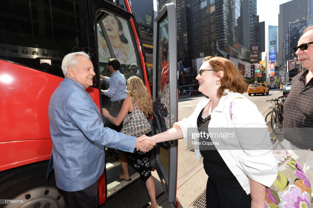 TCM host Robert Osborne (L) launches the 'TCM Classic Film Tour' on August 20, 2013 in New York City. Featuring stops at some of the most famous movie locations throughout the city, this sightseeing bus tour opens to the public Thursday, Aug. 22, running Tuesdays, Thursdays and Saturdays, beginning at 11:30 a.m. The three-hour sightseeing bus tour will take movie fans to some of the city's greatest filming locations, including the Empire State Building (King Kong); Zabar's market (Manhattan, You've Got Mail); Holly Golightly's brownstone (Breakfast at Tiffany's); the famed subway grate that blew Marilyn Monroe's skirt (The Seven-Year Itch); Grand Central Terminal (North by Northwest, Superman); and, of course, Central Park. (Photo by Mike Coppola/WireImage) 23987_004_MC_ 0078.JPG Robert Osborne
