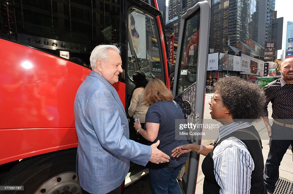 TCM host Robert Osborne (L) launches the 'TCM Classic Film Tour' on August 20, 2013 in New York City. Featuring stops at some of the most famous movie locations throughout the city, this sightseeing bus tour opens to the public Thursday, Aug. 22, running Tuesdays, Thursdays and Saturdays, beginning at 11:30 a.m. The three-hour sightseeing bus tour will take movie fans to some of the city's greatest filming locations, including the Empire State Building (King Kong); Zabar's market (Manhattan, You've Got Mail); Holly Golightly's brownstone (Breakfast at Tiffany's); the famed subway grate that blew Marilyn Monroe's skirt (The Seven-Year Itch); Grand Central Terminal (North by Northwest, Superman); and, of course, Central Park. (Photo by Mike Coppola/WireImage) 23987_004_MC_ 0072.JPG Robert Osborne