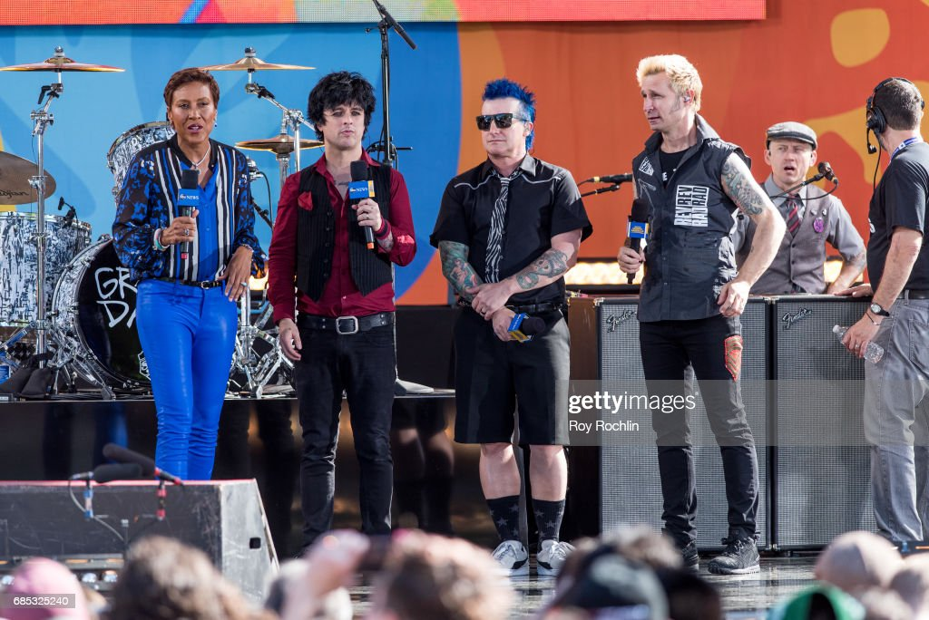 GMA host Robin Roberts with band members Billie Joe Armstrong, Tre Cool and Mike Dirnt as Green Day perform on ABC's 'Good Morning America' at Central Park on May 19, 2017 in New York City.