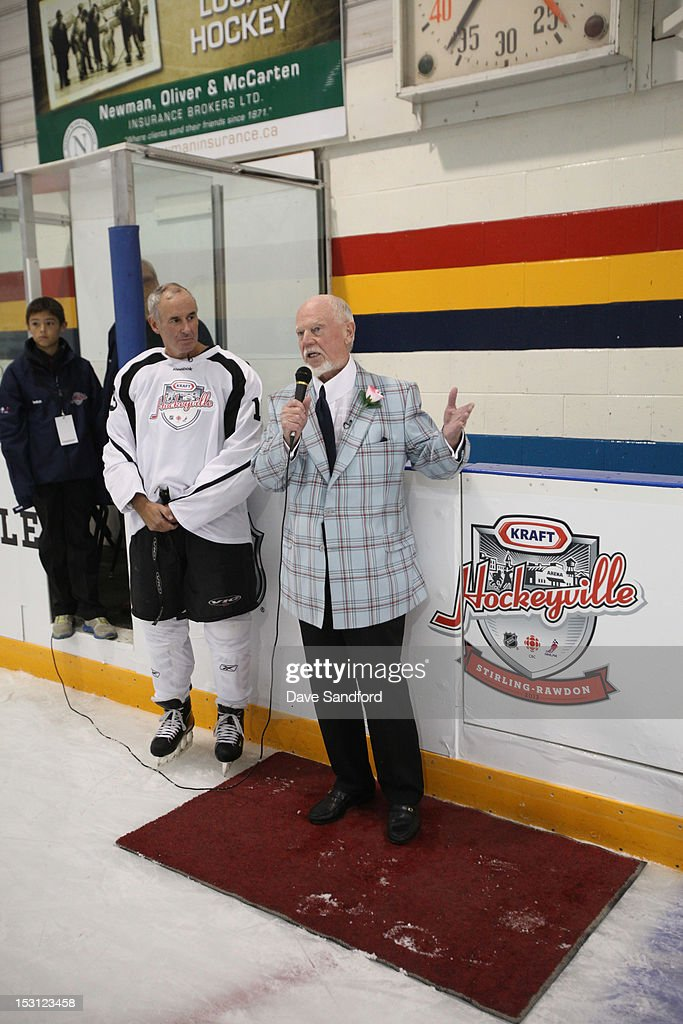 CBC host Ron MacLean speaks with <a gi-track='captionPersonalityLinkClicked' href=/galleries/search?phrase=Don+Cherry+-+Ice+Hockey+Commentator&family=editorial&specificpeople=572764 ng-click='$event.stopPropagation()'>Don Cherry</a> during the Celebrity Hockey Game at the Stirling and District Recreation Centre during Kraft Hockeyville Day 1 on September 30, 2012 in Stirling, Ontario, Canada.