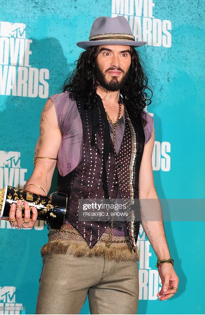 Host Russell Brand poses in the press room at the MTV Movie Awards at Universal Studios, in Los Angeles, California, on June 3, 2012.