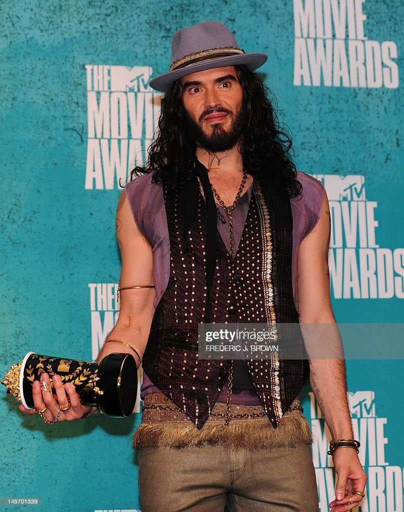 Host Russell Brand poses in the press room at the MTV Movie Awards at Universal Studios, in Los Angeles, California, on June 3, 2012. AFP PHOTO / FREDERIC J. BROWN