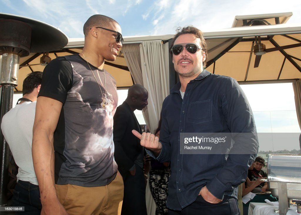 Host Russell Westbrook (L) and David LaChapelle attend Flaunt Magazine and Samsung Galaxy celebrate The Plutocracy Issue release hosted by cover Russell Westbrook at Caulfield's Bar and Dining Room at Thompson Hotel on March 2, 2013 in Beverly Hills, California.