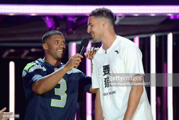 Host Russell Wilson and NBA player Klay Thompson speak onstage during Nickelodeon Kids' Choice Sports Awards 2017 at Pauley Pavilion on July 13 2017...