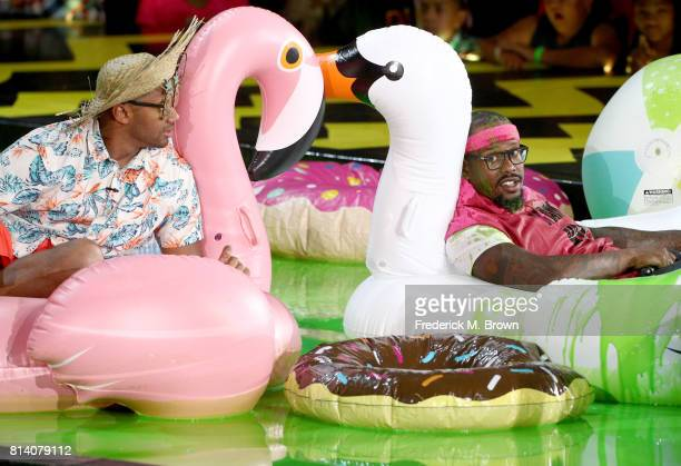 Host Russell Wilson and NFL player Von Miller onstage during Nickelodeon Kids' Choice Sports Awards 2017 at Pauley Pavilion on July 13 2017 in Los...