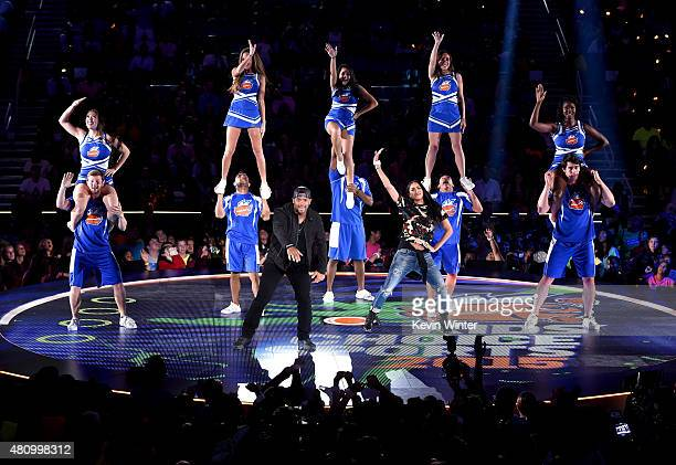 Host Russell Wilson and recording artist Ciara perform onstage at the Nickelodeon Kids' Choice Sports Awards 2015 at UCLA's Pauley Pavilion on July...