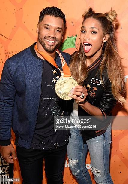 Host Russell Wilson and recording artist Ciara pose backstage during the Nickelodeon Kids' Choice Sports Awards 2016 at UCLA's Pauley Pavilion on...