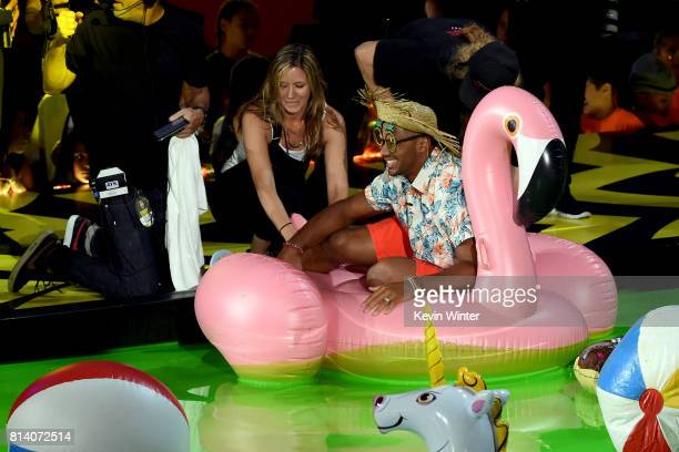 Host Russell Wilson floats in slime pool onstage during Nickelodeon Kids' Choice Sports Awards 2017 at Pauley Pavilion on July 13 2017 in Los Angeles...
