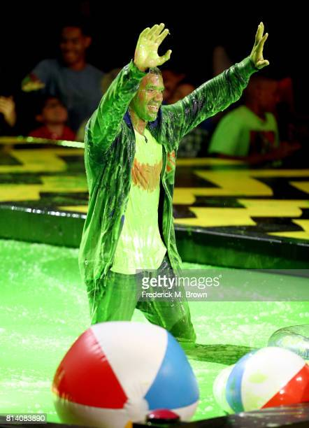 Host Russell Wilson participates in a competition during Nickelodeon Kids' Choice Sports Awards 2017 at Pauley Pavilion on July 13 2017 in Los...