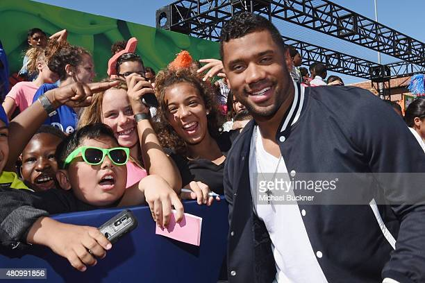 Host Russell Wilson poses with fans at the Nickelodeon Kids' Choice Sports Awards 2015 at UCLA's Pauley Pavilion on July 16 2015 in Westwood...