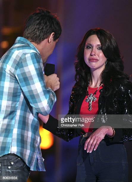 STUDIO CITY CA APRIL 10 Host Ryan Devlin and Chloe Lattanzi daughter of Olivia NewtonJohn during the live taping of 'Rock the Cradle' on April 10...