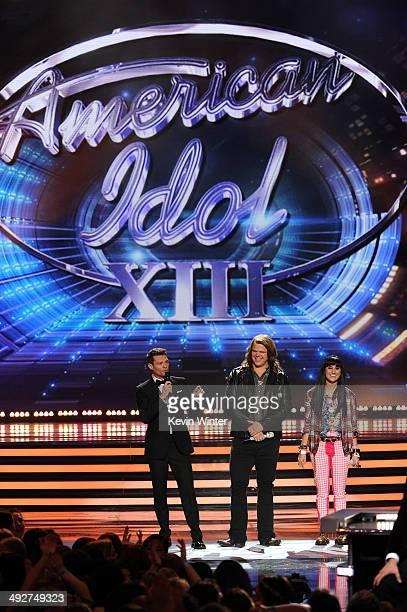 Host Ryan Seacrest American Idol finalists Caleb Johnson and Jena Irene speak onstage during Fox's 'American Idol' XIII Finale at Nokia Theatre LA...