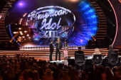 Host Ryan Seacrest American Idol finalists Caleb Johnson and Jena Irene speak onstage during Fox's 'American Idol' XIII Finale at Nokia Theatre LA...