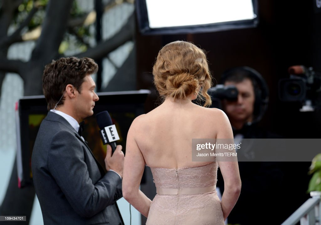 Host Ryan Seacrest (L) and actress Amy Adams (hair detail) at the 70th Annual Golden Globe Awards held at The Beverly Hilton Hotel on January 13, 2013 in Beverly Hills, California.