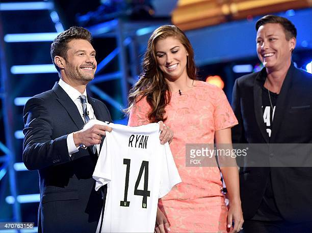 Host Ryan Seacrest and Alex Morgan and Abby Wambach of the National Woman's Soccer Team onstage at FOX's 'American Idol XIV' Top 5 Revealed on April...