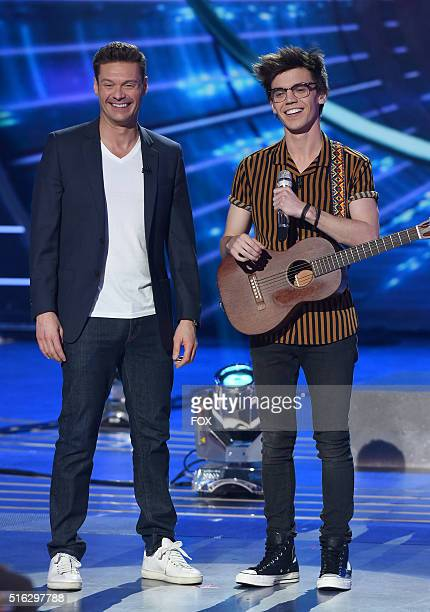 Host Ryan Seacrest and contestant MacKenzie Bourg onstage at FOX's American Idol Season 15 on March 17 2016 in Hollywood California