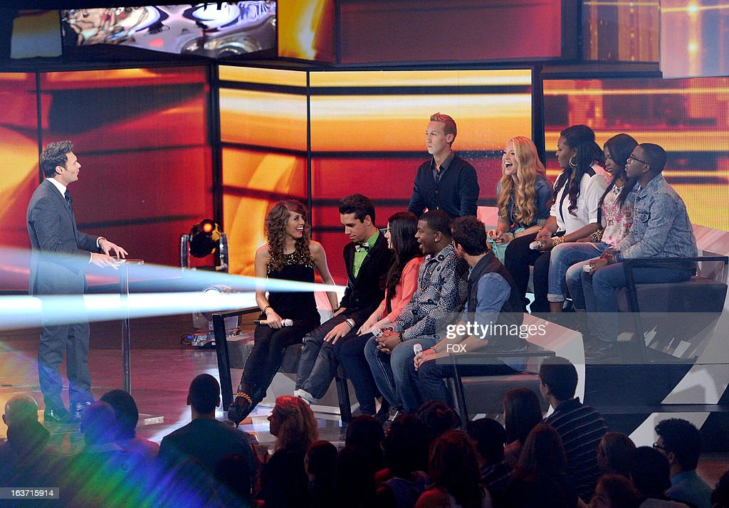Host Ryan Seacrest and contestants (CW top left) Devin Velez, Janelle Arthur, Candice Glover, Amber Holcomb, Burnell Taylor, Paul Jolley, Curtis Finch, Jr., Kree Harrison, Lozaro Arbos and Angie Miller onstage at FOX's 'American Idol' Season 12 Top 10 To 9 Live Elimination Show on March 14, 2013 in Hollywood, California.