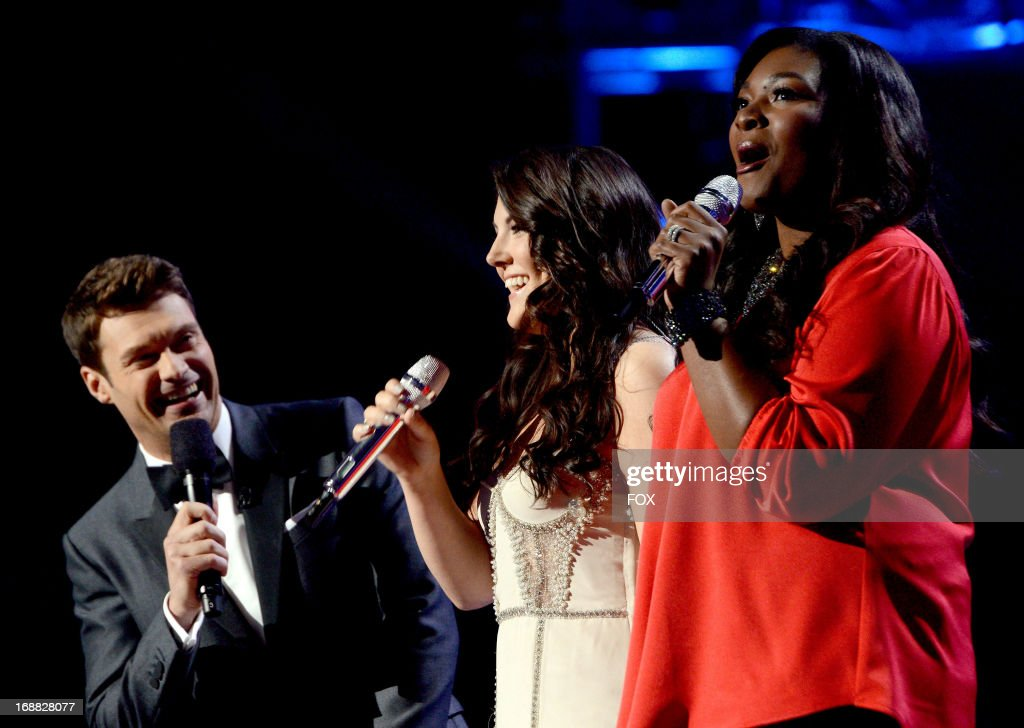 Host Ryan Seacrest (L) and contestants Kree Harrison and Candice Glover (R) onstage at FOX's 'American Idol' Season 12 Top 2 Live Performance Show at Nokia Theatre L.A. Live on May 15, 2013 in Los Angeles, California.