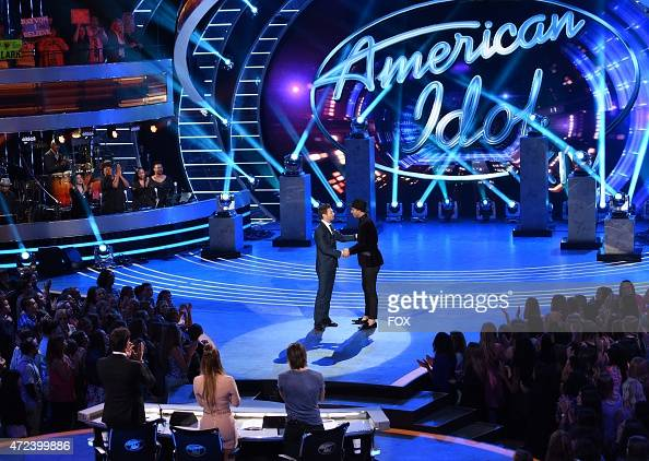 Host Ryan Seacrest and eliminated contestant Rayvon Owen onstage at FOX's 'American Idol XIV' Top 3 Revealed on May 6 2015 in Hollywood California